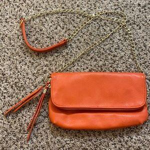Orange fold over crossbody with gold hardware - gently used